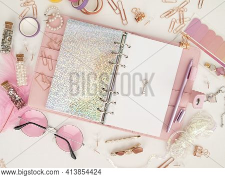 Silver Key On The White Page Of The Planner. Diary Open With White And Holographic Page. Pink Planne