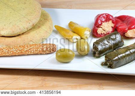 Close Up Of Greek Traditional Appetizer Also Known As Meze, On A Soldes Board