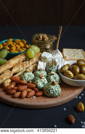 A Set Of Snacks For Wine, Beer. Cheese, Dried Olives, Spinach Balls And Cream Cheese. Breadsticks An