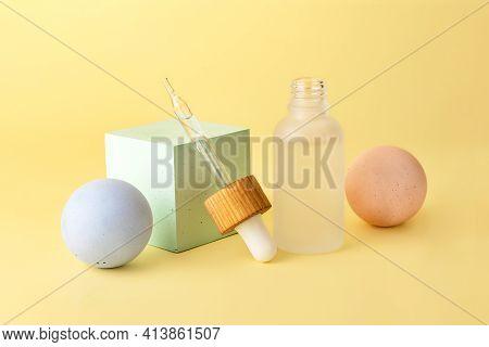 Cosmetics Bottle From Frosted Glass With Dropper Near.empty Geometrical Shape Podiums Near It - Sphe
