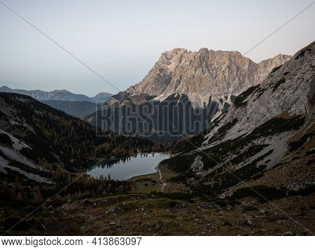 Sunrise Panorama Of Zugspitze Mountain Massif With Calm Alpine Lake Seebensee In Ehrwald Tyrol Austr