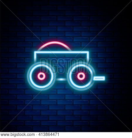 Glowing Neon Line Wooden Four-wheel Cart With Hay Icon Isolated On Brick Wall Background. Colorful O