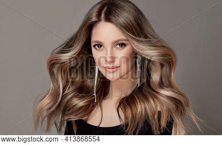 Beauty  Girl With Long  And   Shiny Wavy  Hair ,coloring And Toning, Shatush And Balayash .  Beautif