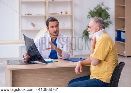 Old neck injured man visiting young male doctor radiologist