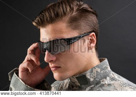 Young military man wearing AR glasses