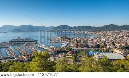 Cityscape of resort town Marmaris in Mugla province, Turkey. Marmaris is a port city and popular tourist resort on the Mediterranean coast in Mugla Province, Turkey.