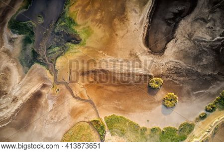 Dry lake or swamp in the process of drought and lack of rain or moisture, a global natural disaster - aerial drone view