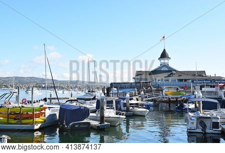 NEWPORT BEACH, CALIFORNIA - JANUARY 6, 2017: The Balboa Pavilion and boats. On Newport Bay the Pavilion is the center of waterfront activities.