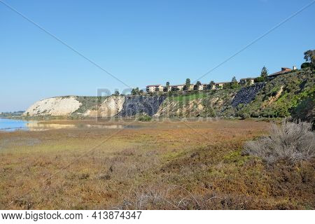 NEWPORT BEACH, CALIFORNIA - JANUARY 16, 2017: Bluffs and Upper Newport Bay Ecological Reserve. With plastic covered hillside to prevent erosion.