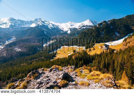 Alpine meadows and snowy peaks in the spring High Tatras mountains. Location place Kalatowki valley, Zakopane, Poland. Photo of nature concept. Springtime wallpaper. Discover the beauty of earth.