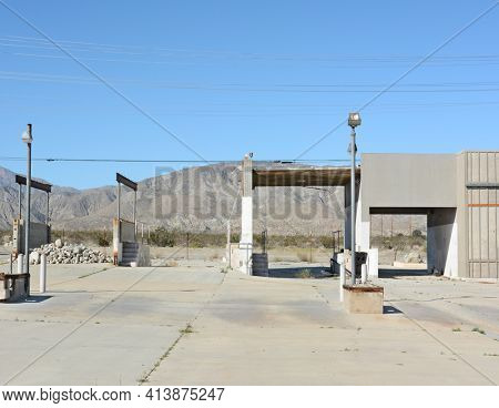 DESERT HOT SPRINGS, CA - FEBRUARY 24, 23015: Abandoned building near Desert Hot Springs, California. Many unfinished construction projects dot the Mojave landscape..