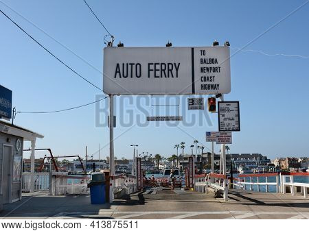NEWPORT BEACH, CA - FEBRUARY 10, 2015: The Balboa Island Ferry.  The ferry's travel about 1000 feet from Balboa Island to the Balboa Peninsula docking about every 5 minutes.