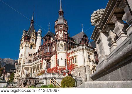 Beautiful Famous Peles Royal Castle And Ornamental Garden In Autumn Season. German Neo-renaissance S