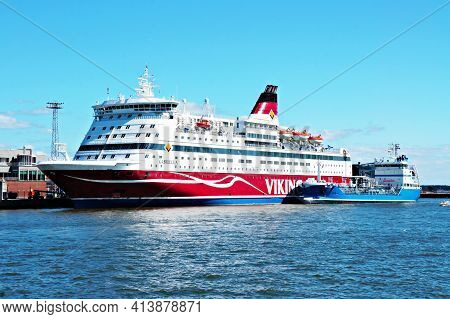 Finland, Helsinki, May 6, 2017 - Large White Cruise Liner Viking Line Standing On The Blue Water Of