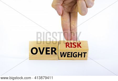 High Risk From Overweight Symbol. Doctor Turns A Cube And Changes The Words Overweight To Over Risk.