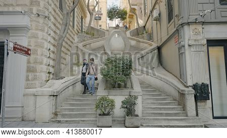 Istanbul, Turkey - March, 2021: Ornate Staircase On Street. Action. Couple Descends Beautiful Curved