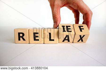 Relief And Relax Symbol. Businessman Turns Cubes And Changes The Word 'relax' To 'relief'. Beautiful
