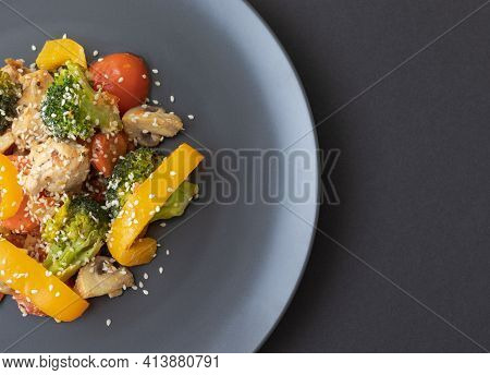Delicious Salad Made Of Broccoli, Cherry Tomatoes, Yellow Pepper, Mushrooms, Pieces Of Chicken Breas