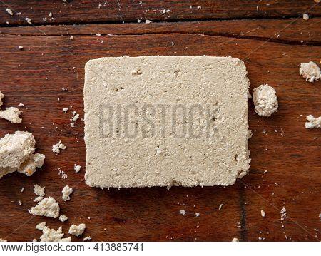 Halva Vanilla Slice On Wooden Table Background, Top View.