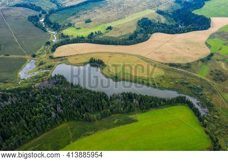 Aerial view of the pond and rural area in Russia