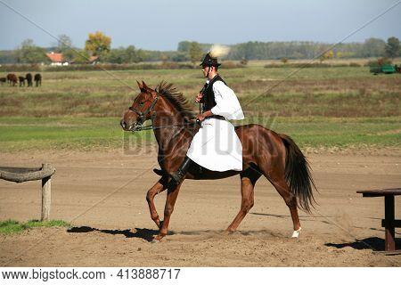 Puszta, Hungary, September, 04. 2020: Hungarian Herdsmen As Csikos In Traditional Folk Costume Showi