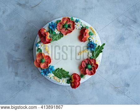 Cake With Buttercream Frosting Decorated With Buttercream Flowers, Poppies, Chamomile, Cornflowers,