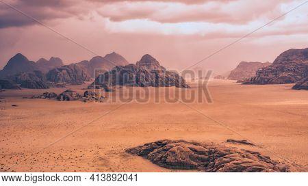 Storm And Rain Clouds Over The Desert Landscape Of Wadi Rum In Jordan
