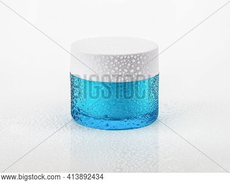 Jar Of Moisturizing Facial Gel And Water Droplets Against White Background. Water Drops On A Blue Co