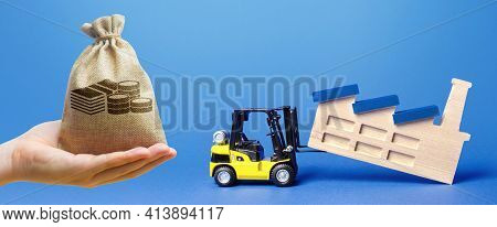 Money Bag, Forklift Truck Transports A Factory Plant To New Location. Revision Of Strategy For Alloc