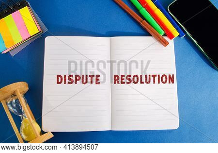 Notebook With Inscription Dispute Resolution. Law And Justice Concept. Litigation, Arbitration, Medi