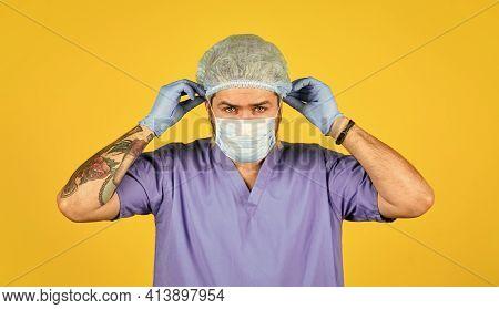 Beginning Of Virus Outbreak. Man Doctor Uniform Yellow Background. Type Of Virus. Coronavirus Concep