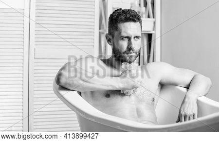 Wash Off Foam With Water Carefully. Macho Enjoying Bath. Sexy Man In Bathroom. Man Wash Muscular Bod