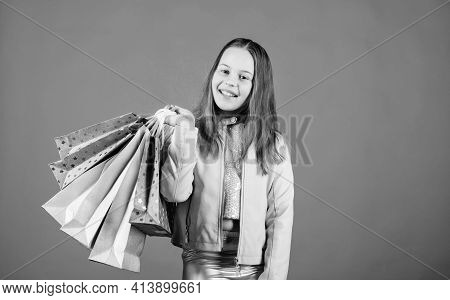 Black Friday Best Deals. Happy Child In Shop With Bags. Shopping Day Happiness. Buy Clothes. Fashion