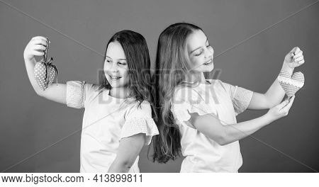 Love Concept. Girls Cute Kids Hold Heart Shaped Toys. Symbol Of Love. Kids Sisters Happy Face Show H