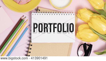 Text Portfolio On White Paper On Pink Background