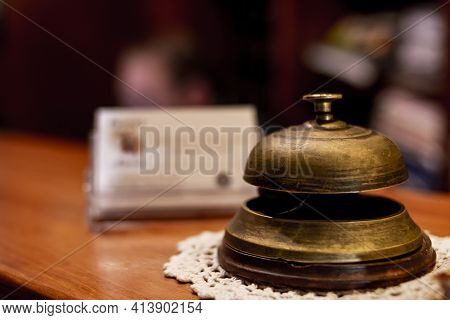 Antique Doorbell Located At The Reception Of A Hotel For The Receptionist's Attention By Guests