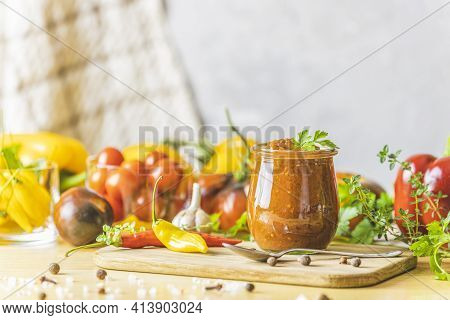 Homemade Diy Natural Canned Hot Plum Sauce Chutney With Chilli Or Tkemali In Glass Jar Standing On W