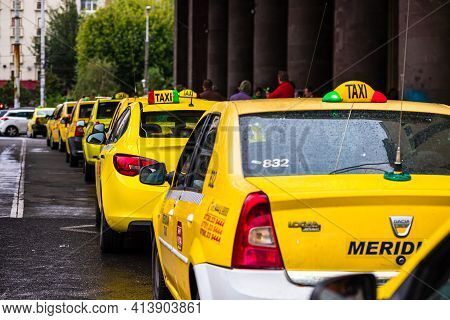 Car In Traffic, Modern City Taxi Service. Taxi Cars Parked At The Taxi Station In The Capital City O