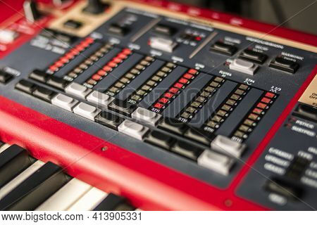 Close-up Of The Hammond Section Of A Professional Red Classic Stage And Live Concert Keyboard, With