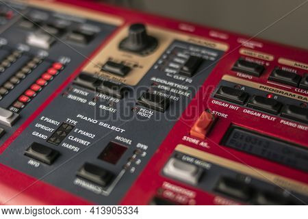 Red, Classic Stage Synthesizer, Famous For Its Sounds And Style, With A Large Keypad For Control And