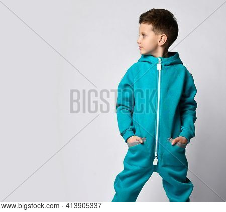 Fashion Boy Child In Warm Sportswear Standing With Hand In Pocket Looking At Left Copy Space. Male K