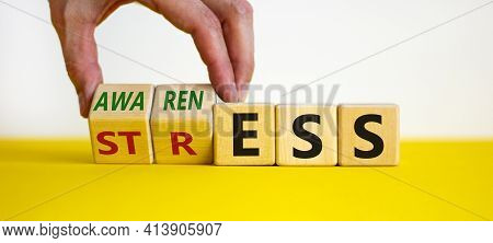 Stress Awareness Symbol. Businessman Turns Cubes And Changes The Word 'stress' To 'awareness'. Beaut