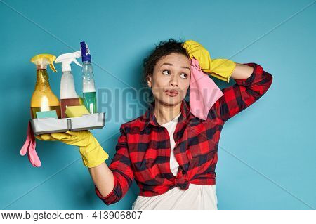 Exhausted Beautiful Woman Housewife Wiping Her Face With A Pink Cleaning Rag, Looking Away, Exhauste