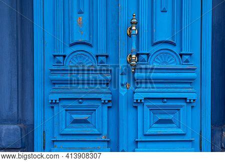 Ornate Door Handle With Old Double Wood Door Painted In Blue. Vintage Wooden Doorway. Classical Arch