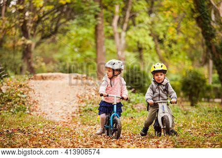 Fearless And Active Girl On A Balance Bike