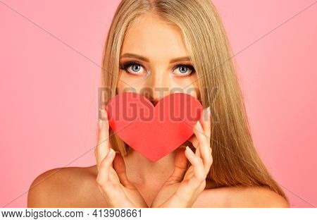 Valentines Day. Attractive Woman With Red Heart. Sensual Girl Covers Lips With Heart.