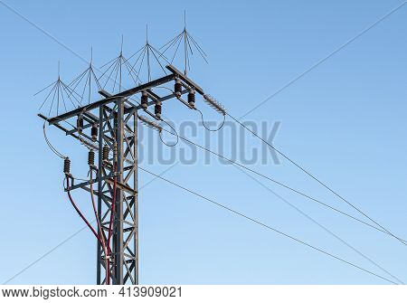Turret With Three Power Lines And Protective Elements. Turret With High Voltage Electricity Cables O