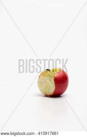 A Ripe Red Apple Isolated On A White Background. Red Bitten Apple On White Background. Apple Clippin