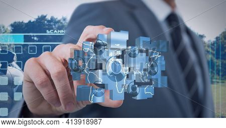 Composition of businessman holding network of digital icons. global technology and digital interface concept digitally generated image.