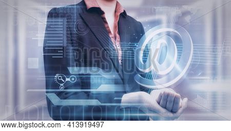 Composition of email digital icon and data processing over hand of businesswoman. global technology and digital interface concept digitally generated image.